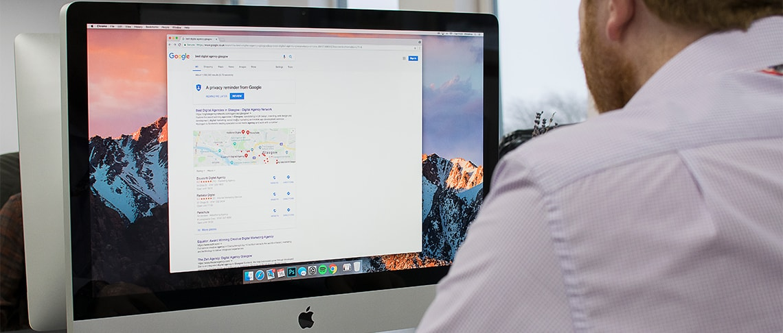 Strive Digital PPC manager working at a computer and Google Search rankings