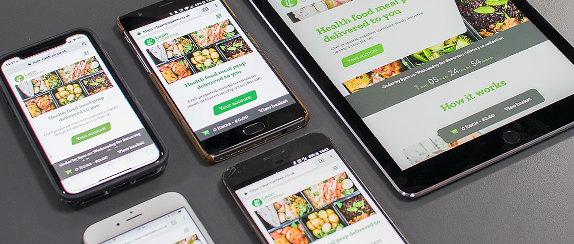 set of mobile devices and a tablet showing the responsive web design of an ecommerce website